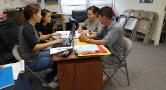 NAKASEC VA staff assisting community members with N-400 paperwork